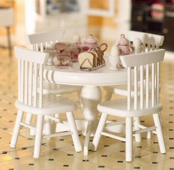 Round White Table and Four Chairs