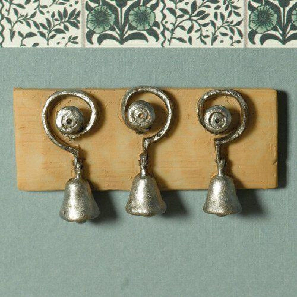 Three Servant Bells Mounted on a Board